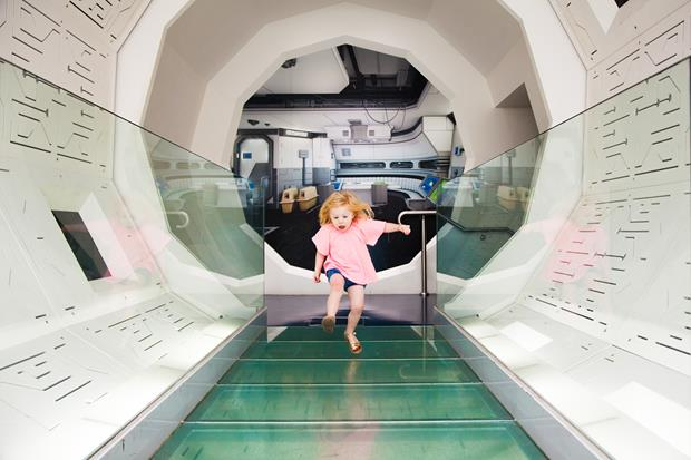 Girl running through a white tunnel