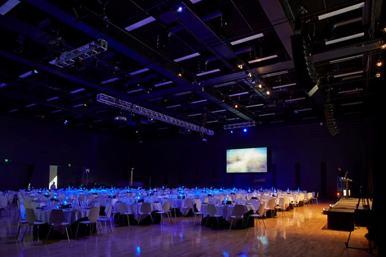 Large room with function tables set up banquet style